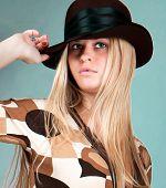 Beautiful fashion woman portrait with brown hat,studio shot