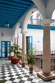 A view of colonial building interior with tropical flowers, Old Havana , Cuba