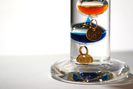 stock photo of galileo-thermometer  - Based on a thermoscope invented by Galileo Galilei in the early 1600s this thermometer is called a Galileo thermometer - JPG
