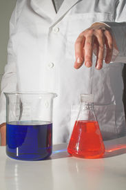 picture of pyrex  - A scientist working with chemicals in a laboratory - JPG