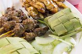 Chicken And Mutton Satay With Ketupat And Cucumbers