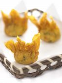 stock photo of wanton  - close up of a basket of fried wantons - JPG
