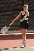 Female Tennis Player Prepares To Serve