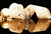 metal and dull golden christmas balls with ribbon