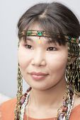 stock photo of chukotka  - Beautiful chukchi woman with decorations in folk dress - JPG