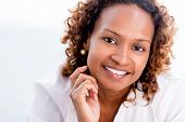 Confident African American business woman - isolated over a white background