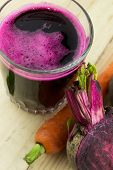 image of beet  - Closeup of Fresh Red Beet Juice close up - JPG