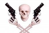 stock photo of cranium  - skull with two skeleton hands holding guns on white background - JPG