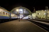 stock photo of loco  - Train at railway station at night in Lvov Ukraine - JPG