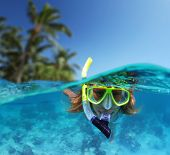 picture of under sea  - Young lady snorkeling in a tropical sea - JPG