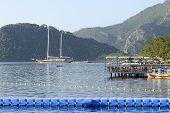 Yacht At The Pier And Outdoor Restaurant On Mediterranean Turkish Resort, Marmaris, Turkey