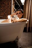 Woman Is Sitting In Bath And Have Videochat By Smartphone