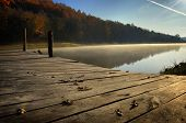 Lake in autumn with pontoon