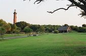 stock photo of whalehead club  - A view of Currituck Lighthouse in Corolla OBX taken from the Whalehead club - JPG