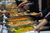 people group catering buffet food indoor in luxury restaurant with meat colorful fruits  and vegetab