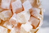 turkish sweet delight, rose and yellow, dusted with caster sugar