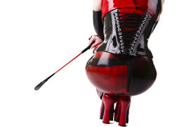 stock photo of fetish clothes  - Woman dressed in dominatrix clothes - JPG