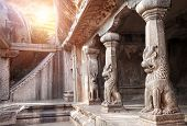 stock photo of tamil  - Ancient cave with animal column in Mamallapuram Tamil Nadu India - JPG