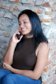 Beautiful Hispanic Girl talking on a cellphone