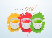 Indian color festival Holi background with buckets with full of colours on grungy colors splash background.