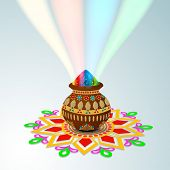 Indian festival Happy Holi celebrations concept, traditional mud pot with full of colors on beautiful rangoli (colorful floral )decorated background.