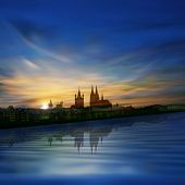 foto of koln  - abstract blue background with sunrise and silhouette of cologne - JPG