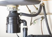 image of sink  - Under the sink garbage disposal unit  - JPG