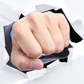 Businessman Punch Through White Paper