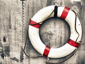 foto of precaution  - life buoy attached to a metal wall on a ship - JPG