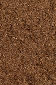 stock photo of humus  - Peat Turf Macro Closeup large detailed brown organic humus soil background pattern vertical - JPG