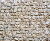 stock photo of fortified wall  - isolated stone brick wall texture old fashioned - JPG