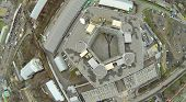 Above view of pentagon shaped building at dull day. View from unmanned quadrocopter