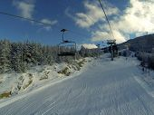 Winter mountains panorama with ski slopes
