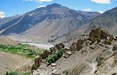 stock photo of himachal  - Panorama of Dhankar village and gompa with high himalays and river valley in background in Spiti valley Himachal Pradesh India - JPG