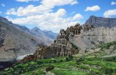 Spectacular View Od Dhankar Village And Gompa With High Himalayas  In Background In Spiti Valley