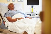 stock photo of ward  - Senior Male Patient Resting In Hospital Bed - JPG