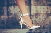 woman leg in high heel shoes outdoor shot
