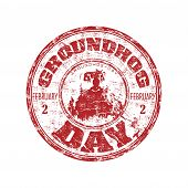 stock photo of spherical  - Red grunge rubber stamp with a little groundhog and the text Groundhog Day written inside the stamp - JPG