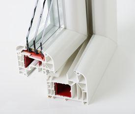 stock photo of white vinyl fence  - Plastic window profile - JPG