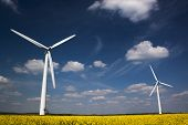 stock photo of rape  - Two wind turbines shot from below - JPG