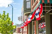 image of democracy  - Patriotic  bunting on a business in a small town - JPG