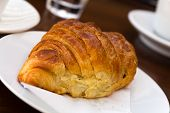 breakfast with fresh croissants , a close up shot