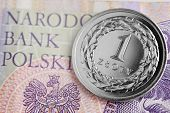 foto of zloty  - Polish coins stacked on a banknote. Polish Zloty -new banknotes.