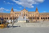 Tourists At The Plaza De Espana In Seville, Spain