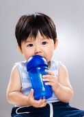Little boy drinking from water bottle