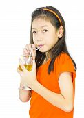 Asian Young Girl Drinks Orange Juice