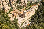 Santa Maria de Montserrat Abbey in Monistrol de Montserrat. View from cableway.