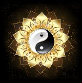 stock photo of plexus  - yin yang symbol drawn in the middle of a lotus with golden petals on a black background - JPG