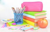 Bright school supplies on table on light background
