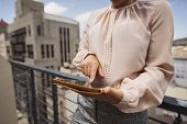 Young Woman Using Tablet Pc On Balcony